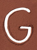 Letter G made of cocoa powder — Stock Photo