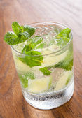 Mojito served in a glass with crushed ice and lime — Stock Photo
