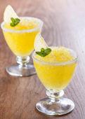 Lemon slushie cups decorated with mint — Stock Photo