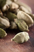 Cardamome seeds on wooden table — Stock Photo