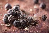 Pile of whole black pepper grains — Stock Photo