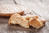 Crushed biscuit on wooden table — Stock Photo