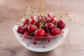 Fresh cherries on cute bowl — Stock Photo