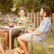 Stock Photo: Couple of friends drinking sangrioutdoors