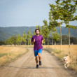 Stock Photo: Guy running with dog
