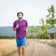 Young man running in the nature — Stock Photo