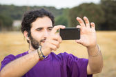 Taking a picture while trekking — Stock Photo