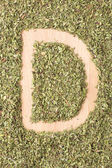 Letter D written with oregano — Stock Photo