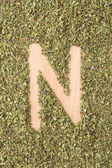 Letter N written with oregano — Stock Photo
