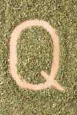 Letter Q written with oregano — Stock Photo