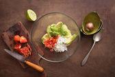 Preparing homemade guacamole on wooden table — Stock Photo