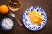 Traditional crepe suzette on wooden table — Stock Photo