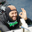 Young man getting ready for scuba diving — Stock Photo