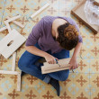 Young woman building piece of furniture — Stock Photo #31953635