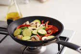 Preparing vegetables in a pan — Stock Photo