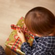 Boy unwrapping a Christmas present — Foto Stock