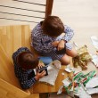 Stock Photo: Siblings unwrapping Christmas presents