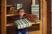 Smiling boy ready to open Christmas presents — Stock Photo