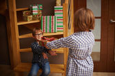 Excited little boy taking a gift from his sister — Stockfoto