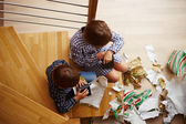 Siblings unwrapping Christmas presents — Stock Photo