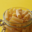 Raw rigatoni paston glass jar — Stock Photo #33320469