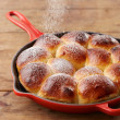 Pouring glasse sugar in brioche ball pie in pan — Stock Photo #33596931