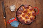 Brioche ball pie in a pan overlook shot — Stock Photo