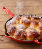 Pouring glasse sugar in brioche ball pie in a pan — Stock Photo