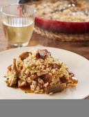 Dish of artichokes and mushrooms rice — Stock Photo