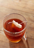 Brown tea on glass cup — Stock Photo
