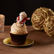 Santa Claus cupcake on Christmas background — Stock Photo