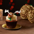 Rudolph reindeer cupcake on Christmas background — Stock Photo