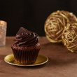 Black chocolate cupcake on Christmas background — Stock fotografie