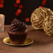 Black chocolate cupcake on Christmas background — Stok fotoğraf