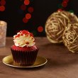 Red velvet cupcake on Christmas background — Stock Photo #35718239