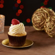 Raspberry cupcake on Christmas background — Stock Photo #35718295