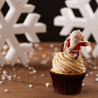 SantClaus cupcake on Christmas background — Stock Photo #35795385