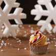 Stock Photo: Candy bar cupcake on Christmas background