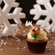 Rudolph reindeer cupcake on Christmas background — Stock Photo #35795443