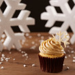 Snowflake cupcake on Christmas background — Stock Photo #35795467
