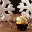 White chocolate cupcake on Christmas background — Stock Photo #35795501