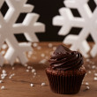 Black chocolate cupcake on Christmas background — Stock Photo #35795561