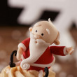 SantClaus cupcake detail on Christmas background — Stock Photo #35795575