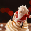 SantClaus cupcake detail on Christmas background — Stock Photo #35795605