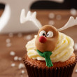 Rudolph reindeer cupcake on Christmas background — Stock Photo #35795665