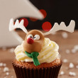 Rudolph reindeer cupcake on Christmas background — Stock Photo #35795697