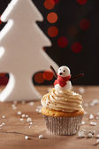 Snowman cupcake on Christmas background — Stock Photo