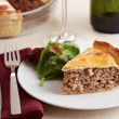 Traditional meat pie on a dish — Stock Photo