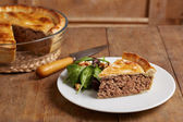 Traditional meat pie on a dish — Stockfoto