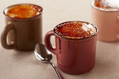Three cups of creme brulee — Stock Photo